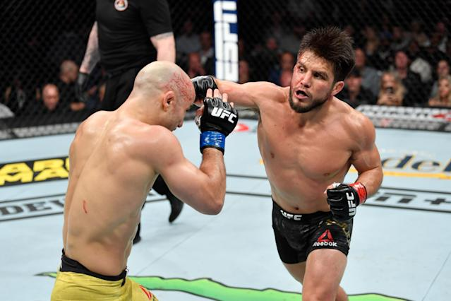 Henry Cejudo punches Marlon Moraes in their bantamweight title bout during UFC 238 at the United Center on June 8, 2019 in Chicago. (Getty Images)