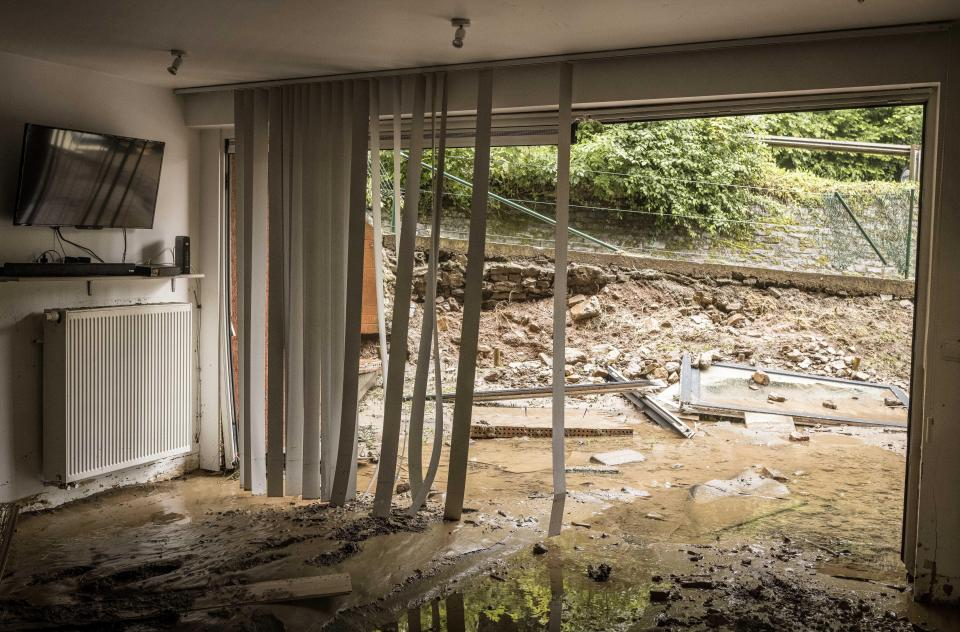 Mud and water fill the ground floor of a flooded house in Méry, in the province of Liège, Belgium, on Thursday