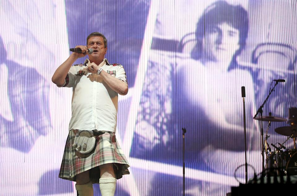 Les McKeown of the Bay City Rollers performing on stage in the King Tut's Wah Wah Tent during the second day of T in the Park, the annual music festival held at Strathallan Castle, Perthshire.