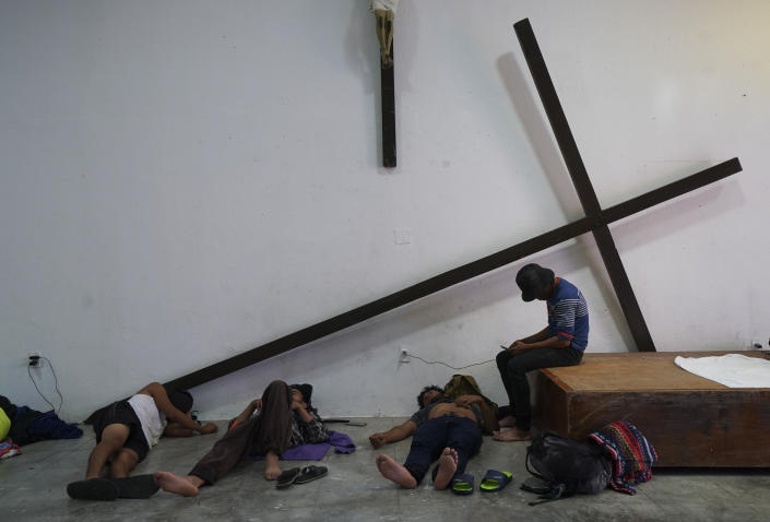 Migrants who are part of a caravan heading north, stop to rest at the church San Francisco de Asis in Huixtla, Chiapas state, Mexico, Sunday, Sept. 5, 2021. (AP Photo/Marco Ugarte)