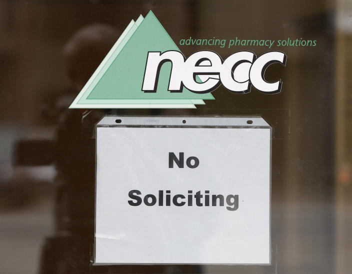 """A sign requesting """"No Soliciting"""" hangs on the door of New England Compounding in Framingham, Mass., Thursday, Oct. 4, 2012. An outbreak of a rare and deadly form of fungal meningitis that has killed 4 people and sickened another 26 in five states is believed to have been traced back to a steroid manufactured by the New England Compounding Center. (AP Photo/Stephan Savoia)"""