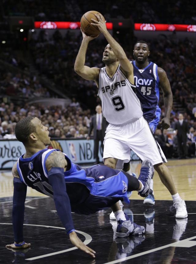 San Antonio Spurs' Tony Parker (9), of France, knocks over Dallas Mavericks' Monta Ellis, left, as he tries to score and Mavericks' DeJuan Blair (45) looks on during the first half of Game 2 of the opening-round NBA basketball playoff series on Wednesday, April 23, 2014, in San Antonio. Parker was called for charging on the play. (AP Photo/Eric Gay)