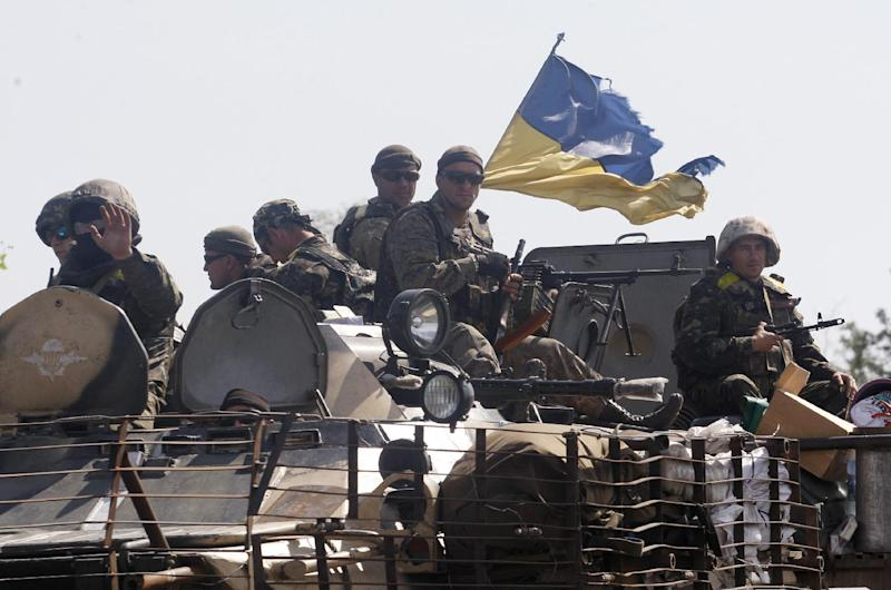 Ukrainian soldiers sit on the top of a armoured personnel carrier as they patrol in Donetsk region on September 3, 2014 (AFP Photo/Anatolii Stepanov)