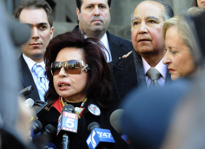 """FILE- In this March 8, 2011, file photo, Sylvia Cachay, mother of Sylvie Cachay, speaks to the media outside State Supreme court in New York as her husband Antonio Cachay, right, looks on. New York City fashion designer Sylvie Cachay was found dead on found Dec. 9, 2010, in a swanky hotel room's overflowing bathtub. Prosecutors say her boyfriend, Nicholas Brooks, the son of Joseph Brooks, an Oscar-winning composer who wrote """"You Light up My Life,"""" strangled Cachay when she tried to end their relationship. (AP Photo/Louis Lanzano, File)"""