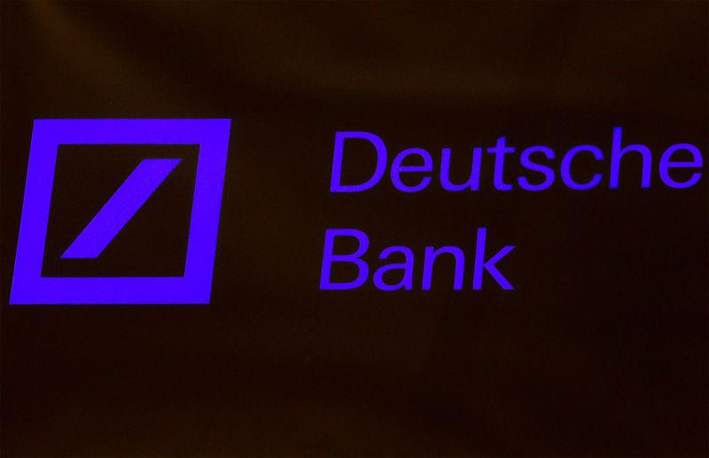 FILE PHOTO: A Deutsche Bank sign is seen on the floor of the New York Stock Exchange