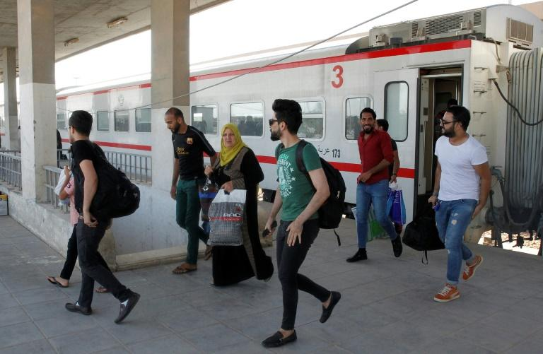 Passengers disembark from a train from Baghdad as it arrives in Fallujah. But there is a long way to go before Iraq's network can host the 72 daily train journeys that were made in the heyday of its railways, before the UN slapped sanctions on the country in the 1990s