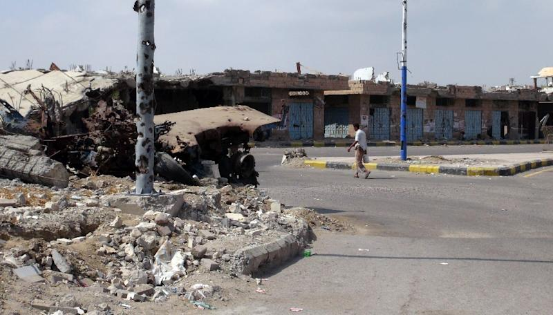 A man walks past destroyed buildings in Zinjibar,  capital of Abyan province in southern Yemen on December 5, 2012, six months after the Yemeni army ousted al-Qaeda loyalists from the region