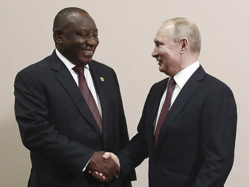 Russian President Vladimir Putin, right, and South Africa's President, Cyril Ramaphosa smile while posing for a photo prior to their talks on the sideline of Russia-Africa summit in the Black Sea resort of Sochi, Russia, Wednesday, Oct. 23, 2019. (Sergei Fadeyechev, TASS News Agency Pool Photo via AP)