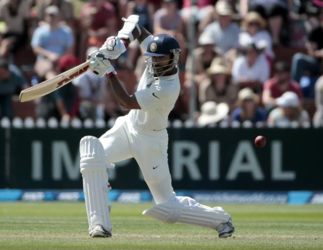 India's Shikhar Dhawan plays a shot against New Zealand during the first innings on day two of the second international test cricket match at the Basin Reserve in Wellington, February 15, 2014. REUTERS/Anthony Phelps (NEW ZEALAND - Tags: SPORT CRICKET)