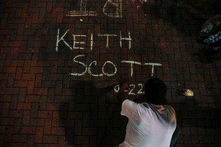 A man writes the name of Keith Scott during a protest against the police shooting of Scott in Charlotte, North Carolina, U.S. September 23, 2016. REUTERS/Jason Miczek
