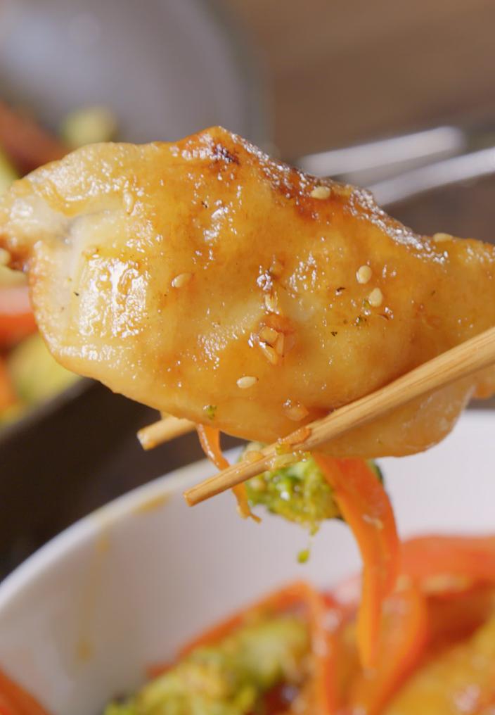 """<p>Is it an appetizer or is it dinner? You decide.</p><p>Get the recipe from <a href=""""https://www.delish.com/cooking/recipe-ideas/recipes/a49914/dumpling-stir-fry-recipe/"""" rel=""""nofollow noopener"""" target=""""_blank"""" data-ylk=""""slk:Delish"""" class=""""link rapid-noclick-resp"""">Delish</a>.</p>"""