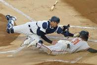 New York Yankees catcher Kyle Higashioka (66) tags Baltimore Orioles Cedric Mullins (31) out at the plate on a fielder's choice during the first inning of a baseball game, Tuesday, April 6, 2021, at Yankee Stadium in New York. Orioles Anthony Santander hit into the play. (AP Photo/Kathy Willens)