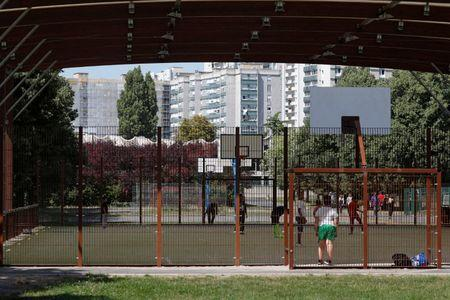 Local youths play basketball at the Marville sports complex, in the Paris suburb of Saint-Denis, France, July 21, 2017. The complex will undergo renovation for water polo competitions as Paris bids to host the 2024 Olympic and Paralympic Games. Picture taken July 21, 2017.   REUTERS/Charles Platiau