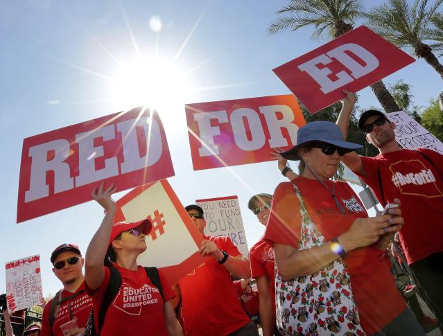 <p>Teachers rally outside the Capitol, Friday, April 27, 2018, in Phoenix on their second day of walkouts. (Photo: Matt York/AP) </p>