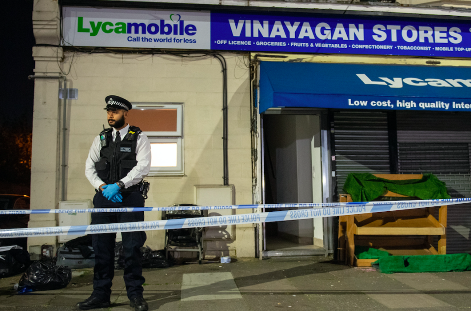 Police attending the scene of the stabbing in Aldborough Road North, Ilford. (PA)