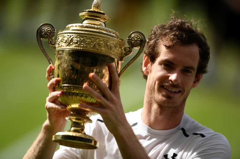 FILE PHOTO: Britain's Andy Murray holds aloft the trophy after winning the 2016 Wimbledon men's singles final