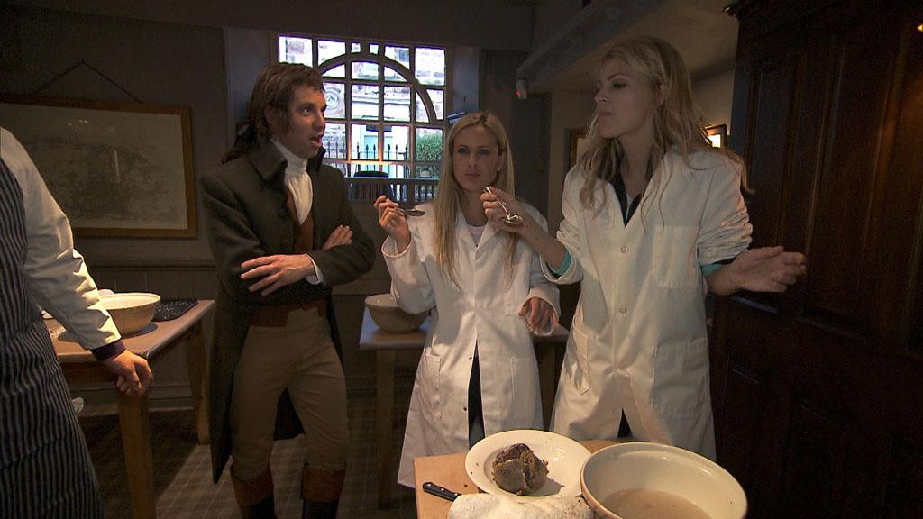 """Working Our Barrels Off"" -- In Detour A, Country singers Caroline (center) and Jennifer (right)must prepare and eat Scotland\'s national dish, Haggis, in order to receive the next clue, on ""The Amazing Race."""