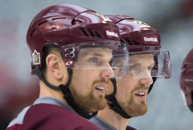 Vancouver Canucks' Henrik Sedin, right, and his twin brother Daniel Sedin, both of Sweden, watch during practice for the Heritage Classic NHL hockey game in Vancouver, British Columbia, on Saturday, March 1, 2014. The Canucks are scheduled to play the Ottawa Senators on Sunday. (AP Photo/The Canadian Press, Darryl Dyck)