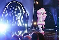 """<p>While interacting with the panelists onstage, the voice of contestants is <a href=""""https://www.eonline.com/news/1008170/margaret-cho-on-life-after-the-masked-singer-it-s-like-bird-box"""" rel=""""nofollow noopener"""" target=""""_blank"""" data-ylk=""""slk:auto-tuned and scrambled"""" class=""""link rapid-noclick-resp"""">auto-tuned and scrambled</a> in a way that's unique to them and used throughout the season. This is done to keep them from being recognized, of course.</p>"""