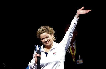 FILE PHOTO: Belgium's Kim Clijsters waves as she arrives to play an exhibition tennis match against Venus Williams of the U.S., marking the end of Clijsters' professional career in Antwerp December 12, 2012. REUTERS/Francois Lenoir