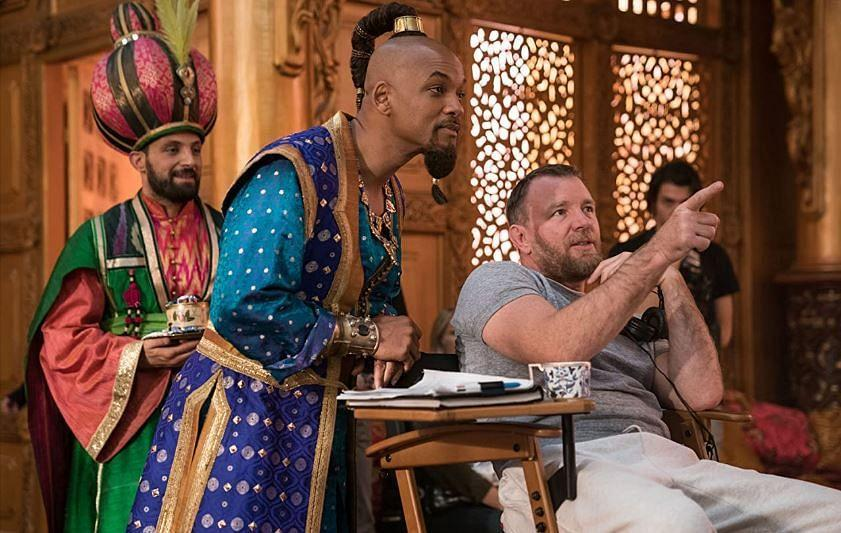 """<div class=""""paragraphs""""><p>Guy Ritchie with Will Smith on the sets of Aladdin</p></div>"""