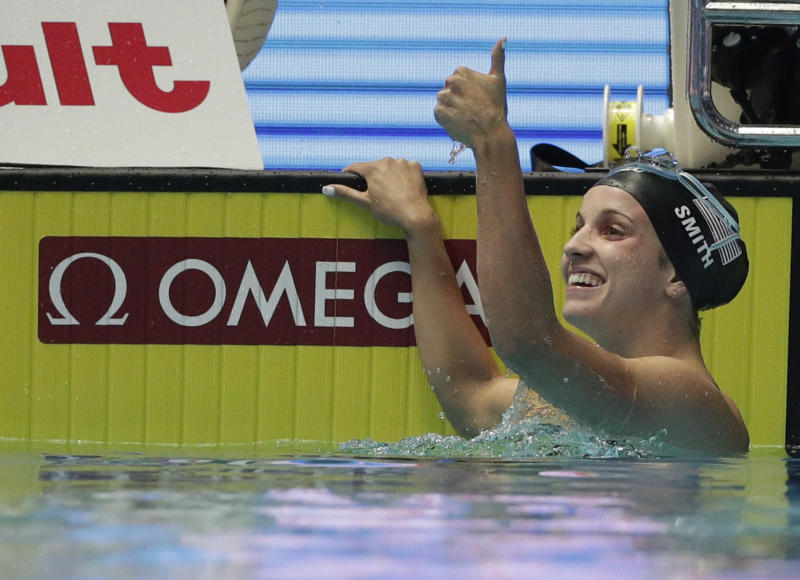 File-This July 26, 2019, file photo shows United States' Regan Smith reacting after her women's 200m backstroke semi final at the World Swimming Championships in Gwangju, South Korea. The teenager from Minnesota broke the world record in the 200 back at the world championships in South Korea in July. Smith turns 18 on Feb. 9. (AP Photo/Mark Schiefelbein, File)