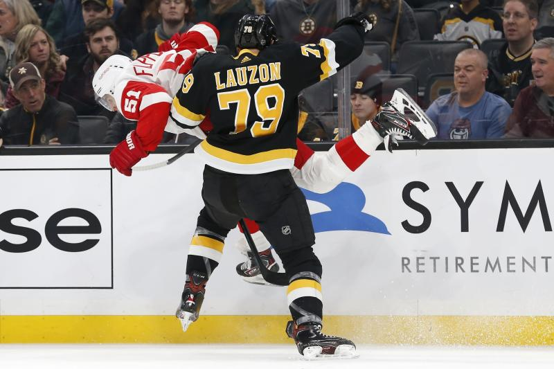 Boston Bruins' Jeremy Lauzon (79) checks Detroit Red Wings' Valtteri Filppula (51) during the first period of an NHL hockey game in Boston, Saturday, Feb. 15, 2020. (AP Photo/Michael Dwyer)