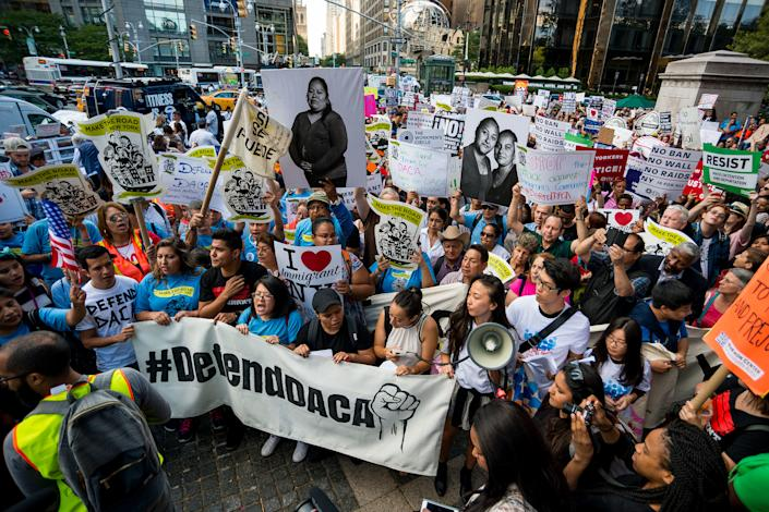 Activists rally in Columbus Circle and marched to Trump Tower in protest of President Donald Trump's possible elimination of the Obama-era