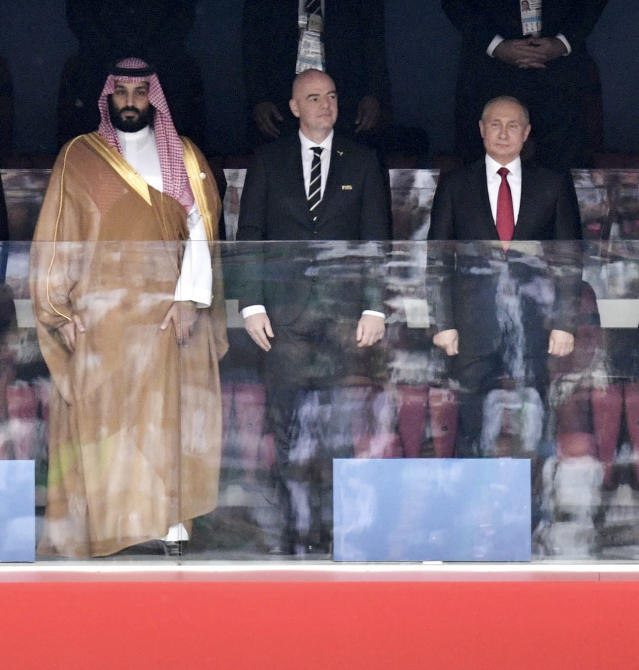 Saudi Arabia Crown Prince Mohammed bin Salman, left, FIFA President Gianni Infantino, center, and Russian President Vladimir Putin stand for the anthem prior to the match between Russia and Saudi Arabia which opens the 2018 soccer World Cup at the Luzhniki stadium in Moscow, Russia, Thursday, June 14, 2018. (Alexei Nikolsky, Sputnik, Kremlin Pool Photo via AP)