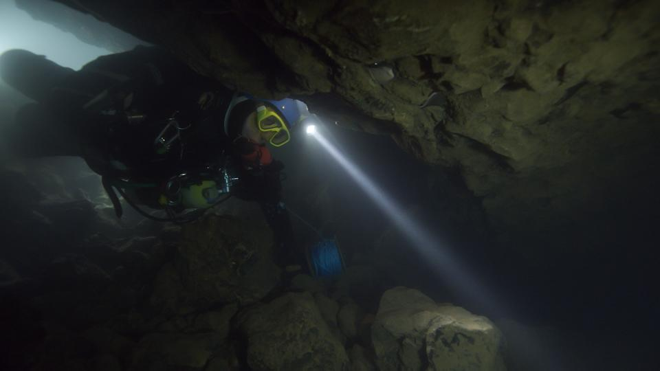 A diver navigates treacherous underwater terrain while on a life-saving mission in the documentary, The Rescue (Photo: National Geographic Documentary Films)