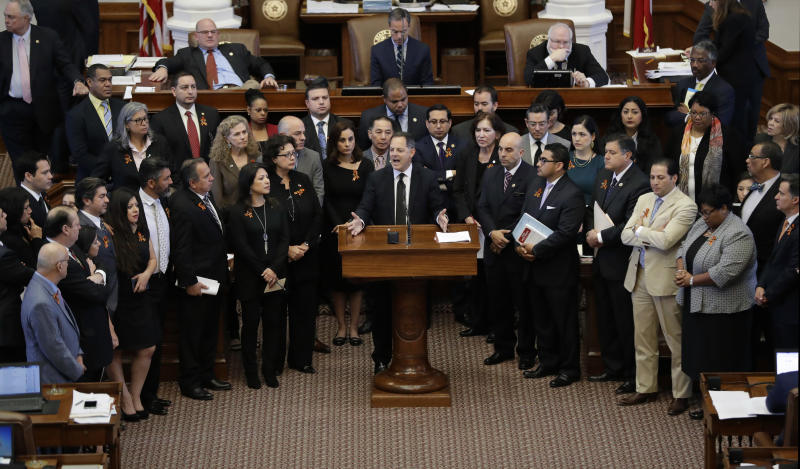 "Texas Rep. Rafael Anchia, D-Dallas, at podium, is surrounded by fellow lawmakers as he speaks against an anti-""sanctuary cities"" bill that has already cleared the Texas Senate and seeks to jail sheriffs and other officials who refuse to help enforce federal immigration law, Wednesday, April 26, 2017, in Austin, Texas. (AP Photo/Eric Gay)"