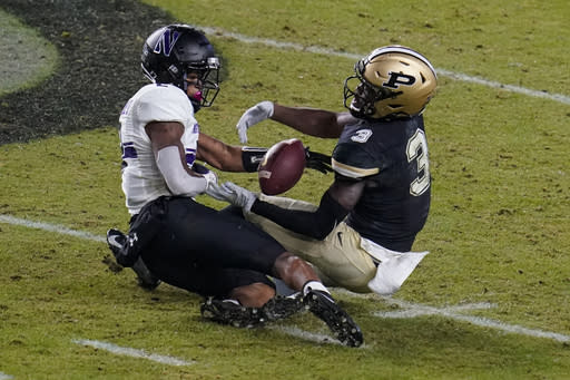 Northwestern defensive back Greg Newsome II (2) breaks up a pass to Purdue wide receiver David Bell (3) during the first half of an NCAA college football game in West Lafayette, Ind., Saturday, Nov. 14, 2020. (AP Photo/Michael Conroy)