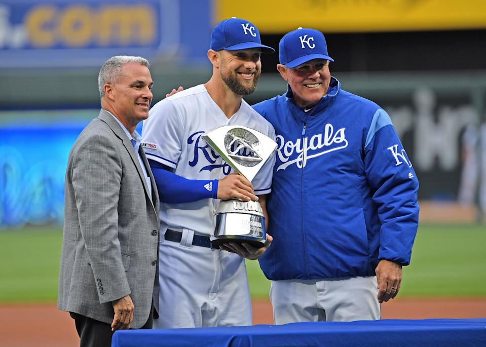 Apr 13, 2019; Kansas City, MO, USA; Kansas City Royals left fielder Alex Gordon (center) receives the Defensive Player of the Year Award from General Manager Dayton Moore (left) and manager Ned Yost (right), prior to the start of the game against the Cleveland Indians at Kauffman Stadium. Mandatory Credit: Peter G. Aiken/USA TODAY Sports