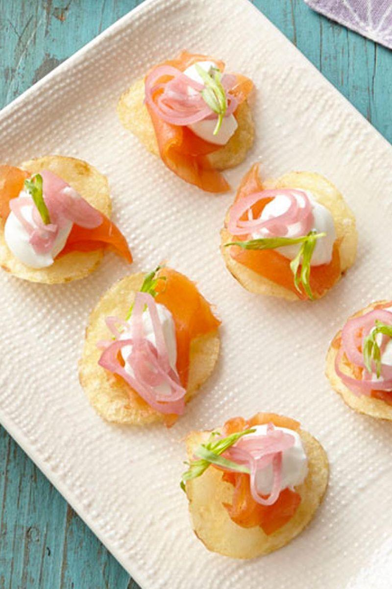 """<p>This Thanksgiving appetizer may be small, but it's big on flavor. </p><p><a href=""""https://www.womansday.com/food-recipes/food-drinks/recipes/a39877/smoked-salmon-bites-recipe-ghk0414/"""" rel=""""nofollow noopener"""" target=""""_blank"""" data-ylk=""""slk:Get the Smoked Salmon Bites recipe."""" class=""""link rapid-noclick-resp""""><em>Get the Smoked Salmon Bites recipe.</em></a> </p>"""