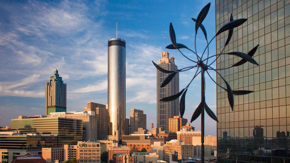 Atlanta, Georgia, USA – July 26, 2015: Sunset panoramic aerial view of Atlanta skyline, with the Westin Peachtree Plaza skyscraper at its center, with a mobile sculpture of the SkyLounge rooftop terra - Image.