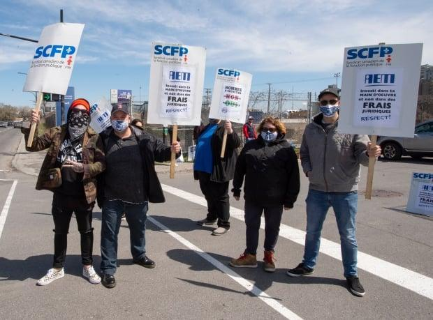 More than 1,000 dock workers walked off the job at the Port of Montreal on Monday. They have been without a contract since 2018.  (Ryan Remiorz/The Canadian Press - image credit)