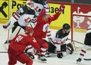 Yevgeni Timkin of Russia, centre, celebrates a goal against Darcy Kuemper of Canada during the Ice Hockey World Championship quarterfinal match between Russia and Canada at the Olympic Sports Center in Riga, Latvia, Thursday, June 3, 2021. (AP Photo/Roman Koksarov)