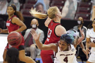 South Carolina forward Aliyah Boston (4) and North Carolina State center Elissa Cunane (33) vie for a rebound during the first half of an NCAA college basketball game Thursday, Dec. 3, 2020, in Columbia, S.C. (AP Photo/Sean Rayford)