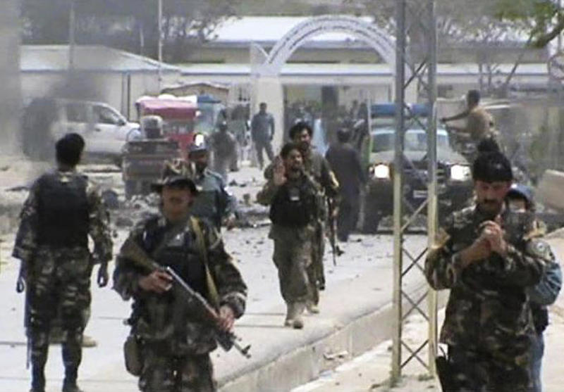 This image made from AP video shows Afghan National Army soldiers rushing to the scene moments after a car bomb exploded in front the PRT, Provincial Reconstruction Team, in Qalat, Zabul province, southern Afghanistan, Saturday, April 6, 2013. Six American troops and civilians and an Afghan doctor were killed in attacks on Saturday in southern and eastern Afghanistan as the U.S. military's top officer began a weekend visit to the country, officials said.  (AP Photo via AP video)
