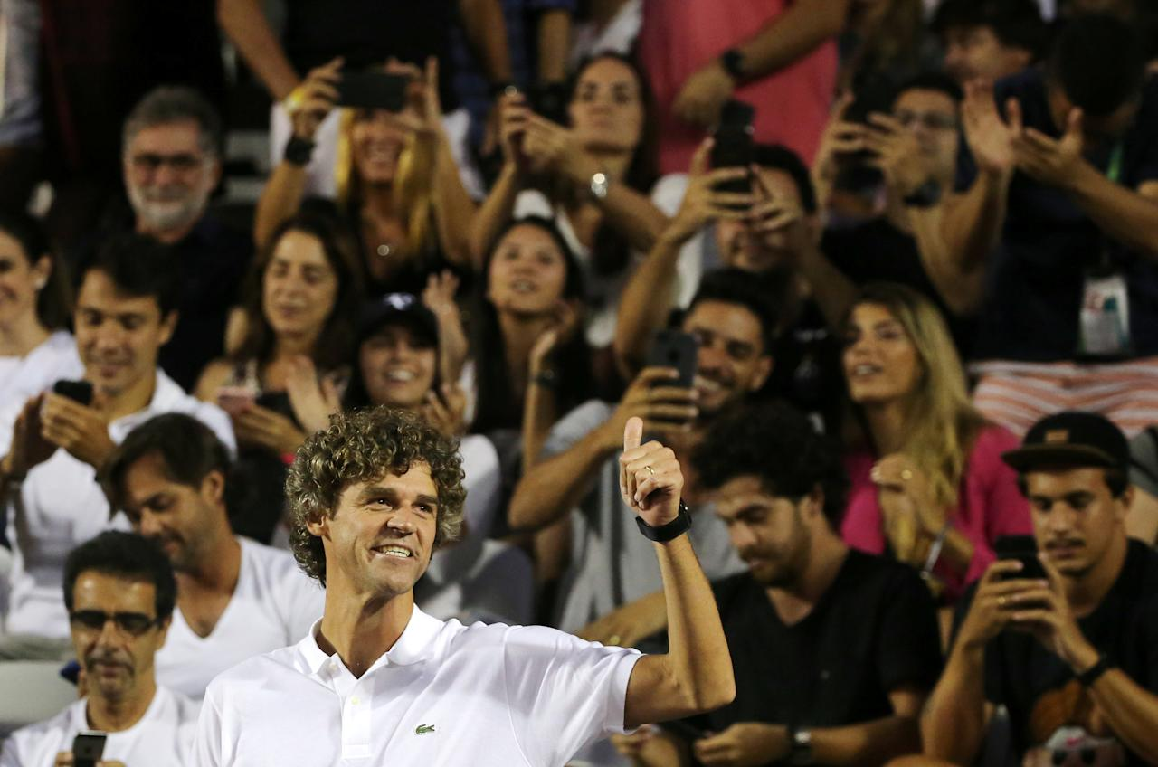 Tennis - ATP 500 - Rio Open - Quarterfinal - Rio de Janeiro, Brazil - February 23, 2018 Former tennis player Gustavo Kuerten waves to fans during the match between Gael Monfils of France and Diego Schwartzman of Argentina. REUTERS/Sergio Moraes