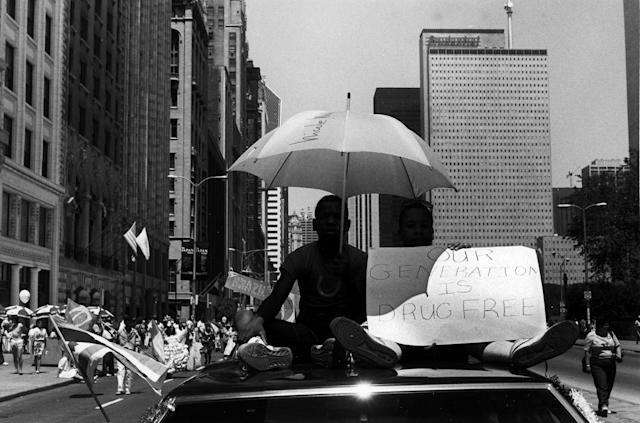 "<p>Two boys riding on the roof of a car in the Fourth of July Parade, hold a sign that reads: ""Our generation is drug free,"" on Michigan Avenue near Adams Street, Chicago, Ill., 1988. (Photo: David Dapogny/Chicago History Museum/Getty Images) </p>"