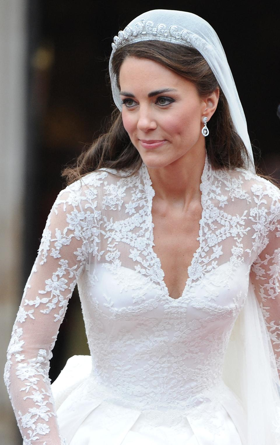 Kate, Duchess of Cambridge, comes out of Westminster Abbey, with her husband Britain's Prince William (not pictured) following their wedding ceremony, in central London, on April 29, 2011. AFP PHOTO / CARL DE SOUZA (Photo by Carl DE SOUZA / AFP) (Photo by CARL DE SOUZA/AFP via Getty Images)