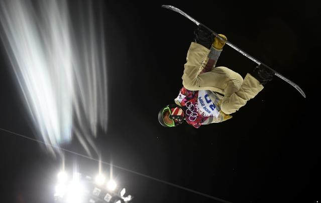 Shaun White of the U.S. performs a jump during a training session for the snowboard men's halfpipe competition at the 2014 Sochi Winter Olympic Games in Rosa Khutor February 10, 2014. REUTERS/Dylan Martinez (RUSSIA - Tags: SPORT OLYMPICS SPORT SNOWBOARDING TPX IMAGES OF THE DAY)