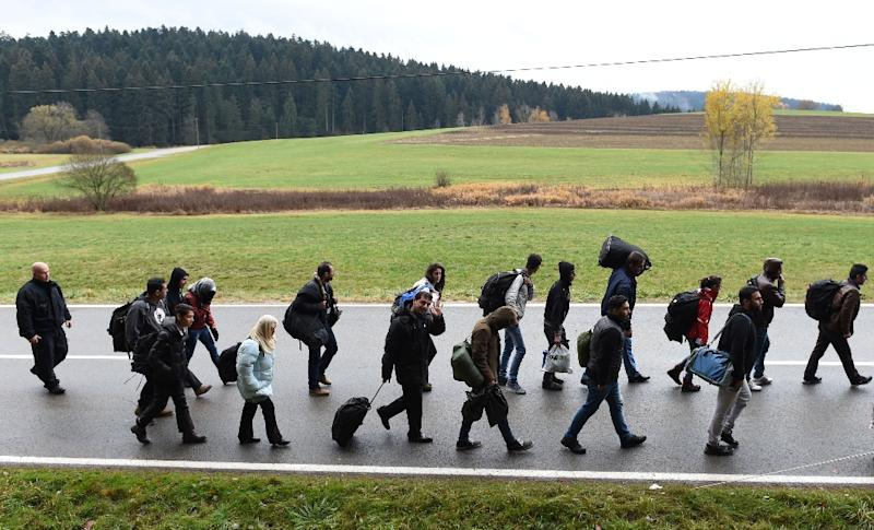 Migrants on the road after crossing the Austrian-German border near the Bavarian village of Wegscheid, southern Germany on November 9, 2015