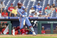 Philadelphia Phillies' Andrew McCutchen (22) hits an RBI single during the fifth inning of a baseball game against the Washington Nationals, Thursday, July 29, 2021, in Philadelphia in the second game of a doubleheader. (AP Photo/Laurence Kesterson)