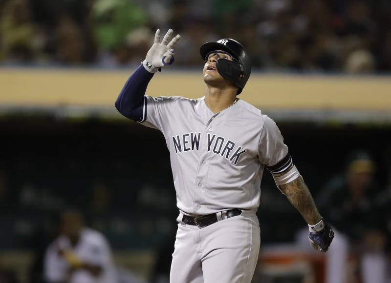 New York Yankees' Gleyber Torres celebrates after hitting a home run off Oakland Athletics' Tanner Roark during the seventh inning of a baseball game Thursday, Aug. 22, 2019, in Oakland, Calif. (AP Photo/Ben Margot)