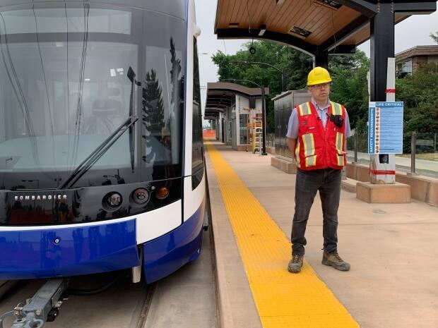 Dallas Lindskoog, TransEd's communications manager, stands on the platform Tuesday at the Valley Line Southeast LRT's stop in Strathearn, southeast of downtown. (Min Dhariwal/CBC - image credit)