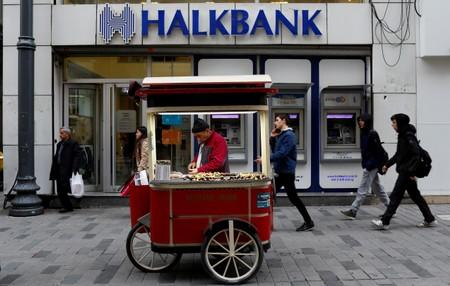 FILE PHOTO: A street vendor sells roasted chestnuts in front of a branch of Halkbank in central Istanbul
