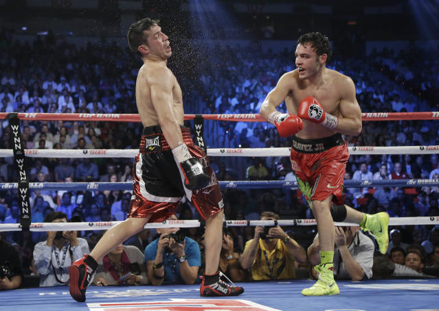 Julio Cesar Chavez Jr., right, lands a punch against Sergio Martinez during the WBC middleweight title fight, Saturday, Sept. 15, 2012, in Las Vegas. Martinez won by unanimous decision. (AP Photo/Julie Jacobson)