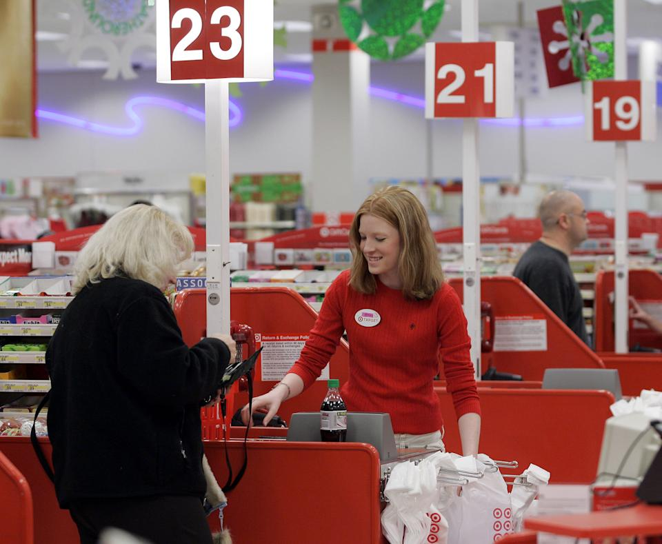 Cashier Nora Poage rings up a purchase at a Target store in Seattle Wash. Friday, Nov. 18, 2005. Last holiday season, Wal-Mart Stores Inc. gave Target Corp. a nice Christmas present: being asleep when it came to deep discounts and not being stocked with some of the must-have items. This holiday season, the world's largest retailer plans to upstage its rival, with trendier fashions and electronic gadgets that appeal to a broader range of its customers.  (AP Photo/Ted S. Warren)